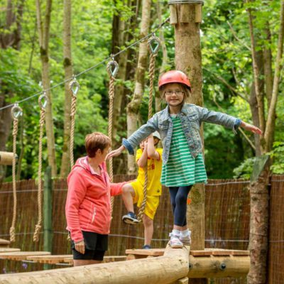 Little girl balancing in junior woodland