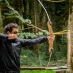 Man shooting bow and arrow