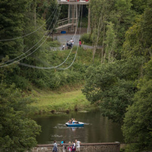 Zipline, bridge and boat on lake