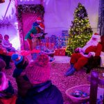 Santa and group of children during Christmas event