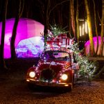 Domes and old VW car with christmas lights and presents 2