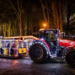 Train with fairy lights during christmas and tractor