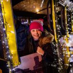 Train with fairy lights during christmas child smiling