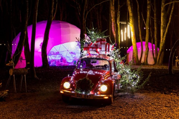 Domes and old VW car with christmas lights and presents