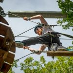 Man on high ropes octagon course 4