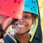 women smiling with helmet on