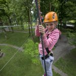 Girl on junior high ropes course