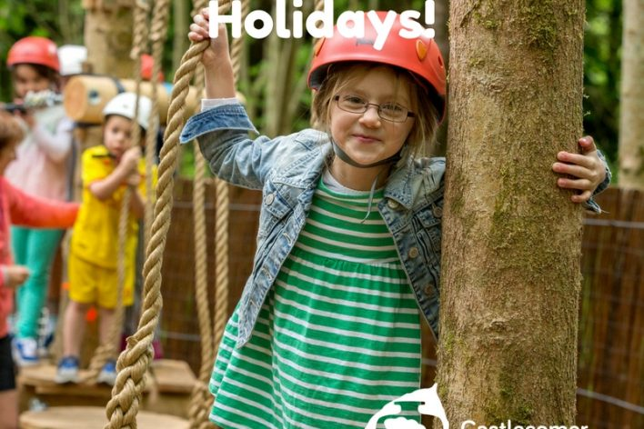 Children on junior low ropes course, holiday flyer