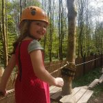 Child on junior ropes course smiling