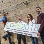 Business people with Core2018 sign